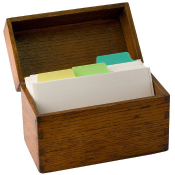 A wooden box with tabbed index cards portrays the process of SEO (search engine optimization).