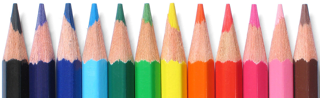 A row of vibrant colored pencils portrays the art of effective website design.