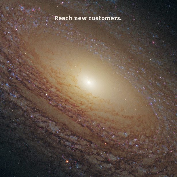 An expansive galaxy reaches out in all directions from a bright center point with text 'Reach new customers.'