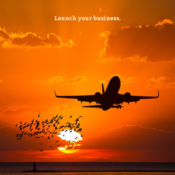 Silhouette of an airplane taking off during sunset with text 'Launch your business.'